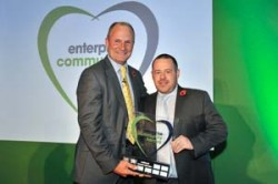 Winner of the National Community Hero Award 2014 Adrian Emmett collecting trophy