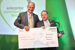 Winner of the National Community Hero Award 2014 Adrian Emmett with winners cheque for £10,000