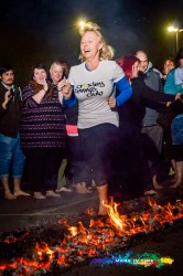 Firewalk for Peace hospice care charity lady walking on hot embers watford mark in time photography events