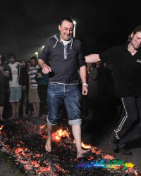 charity firewalk man walking on hot embers to raise money for Peace Hospice Care Watford Mark In Time Photography events