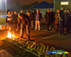 fire being lit for a charity firewalk mark in time photography