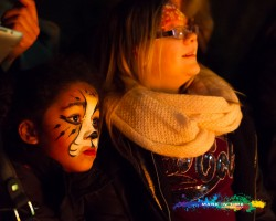Charity firewalk in aid of the peace hospice watford facepainted girl watching the action