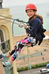 Young girl taking part in charity abseil Mark In Time Photography