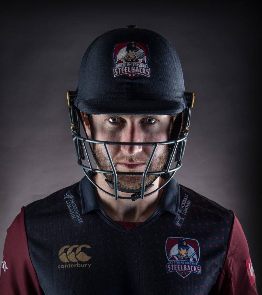 Cricket player, headshot, menacing, grey backdrop, flash, coprporate, sport, portrait, photography